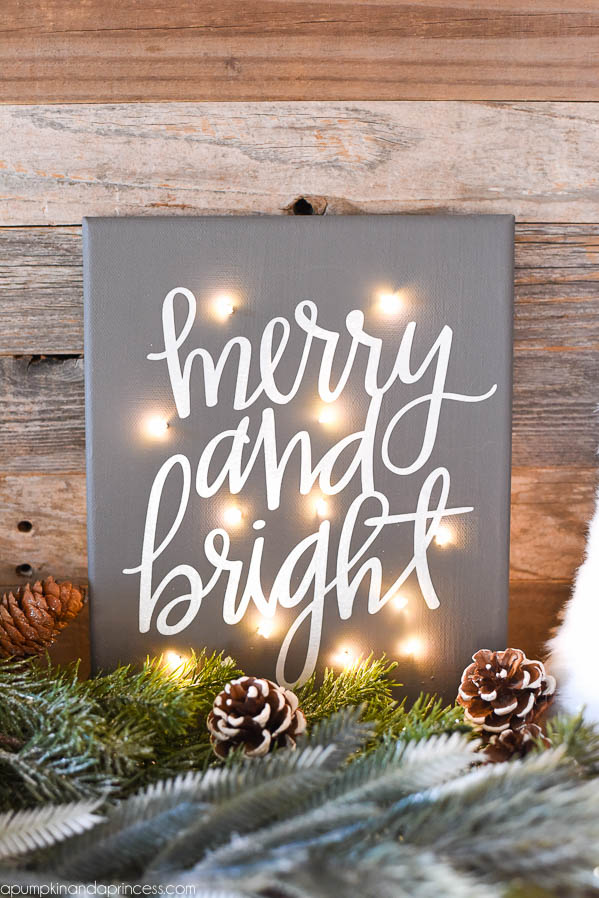 DIY Twinkle Light Christmas Canvas - how to make a Merry & Bright Christmas canvas with fairy lights