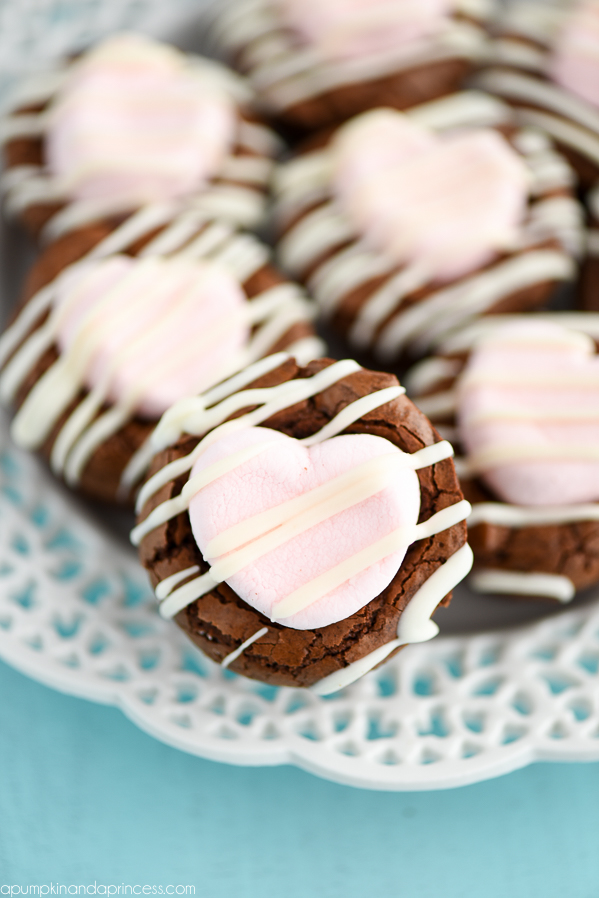 Marshmallow Brownie Bites Recipe - mini brownies topped with strawberry marshmallows and white chocolate