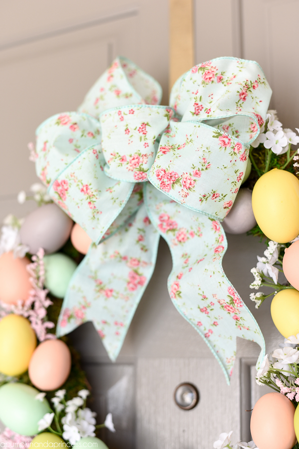 Easter Egg Wreath - create a beautiful Spring wreath with easter eggs, moss, and flowers. Add a pink and mint floral bow and you have a pretty DIY Easter egg wreath to welcome guests.