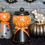 How to make a Halloween candy jar made out of a terra cotta pot, saucer, a glass bowl and wooden knob. Perfect for decorating and displaying your favorite Halloween treats!