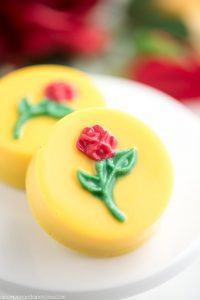 Beauty and the Beast Cookies - chocolate covered OREO cookies topped with a rose, perfect for a Beauty and the Beast party!
