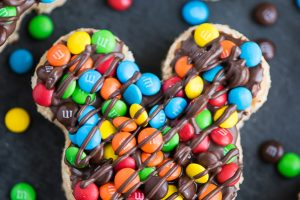 Mickey Rice Krispies Treats – Disneyland inspired Mickey shaped Rice Krispies treats dipped in chocolate and topped with mini M&M's.