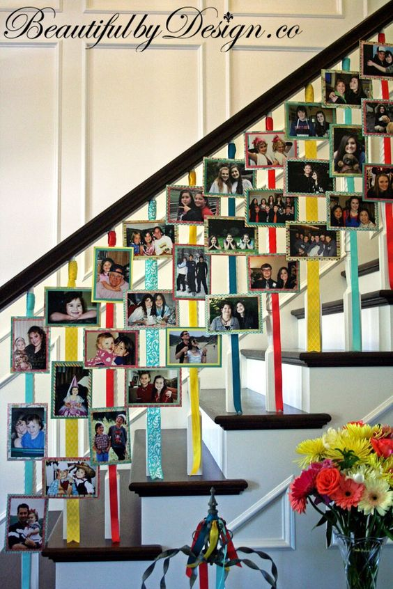 pictures hung on staircase decoration