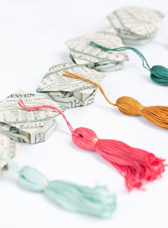 money shaped into graduation caps