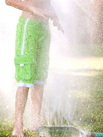 kids playing water sprinkler