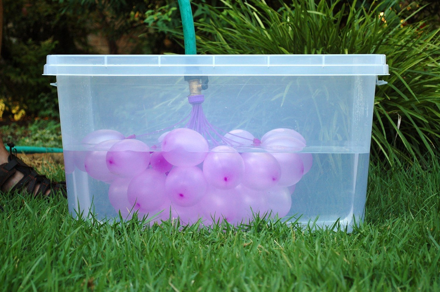 water balloons filling in tub