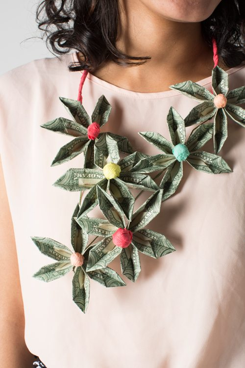 money shaped into flower necklace