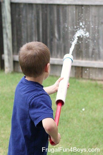 kid playing with water gun