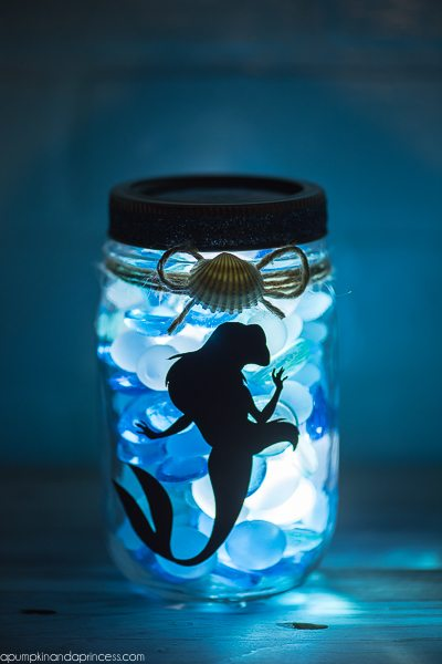 DIY The Little Mermaid Mason Jar Light - create an ocean inspired mason jar night light with a vinyl Ariel decal and LED light.