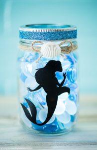 DIY The Little Mermaid Mason Jar Light - create an ocean inspired mason jar night light with a vinyl Ariel decal and LED light.