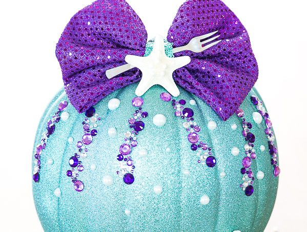 DIY No-Carve Little Mermaid Pumpkin – how to make a Disney Ariel inspired pumpkin with glitter, pearls, seashells and a mini fork to complete your under the sea creation.