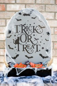 DIY Halloween Candy Holder – create a Tombstone Candy Holder out of a 2x2 piece of plywood and paint!