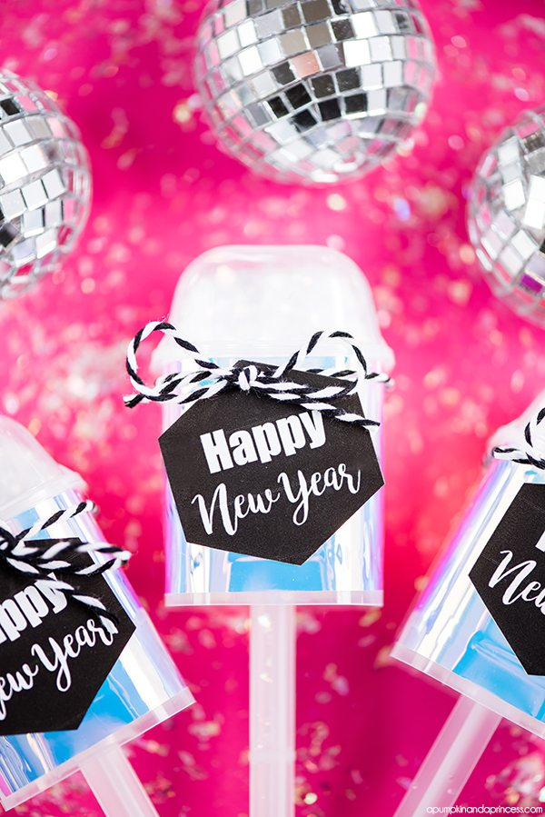 DIY Holographic Confetti Push Up Pops – create mini confetti push up poppers with mirrored tape and printable tags for your New Year's Eve party.