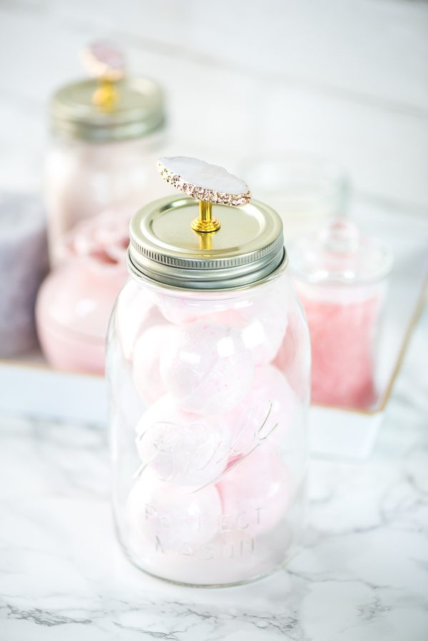 Mason Jar Bathroom Vanity Organizer – how to organize bath essentials like bath bombs, oils, and bath salts on your vanity using mason jars.