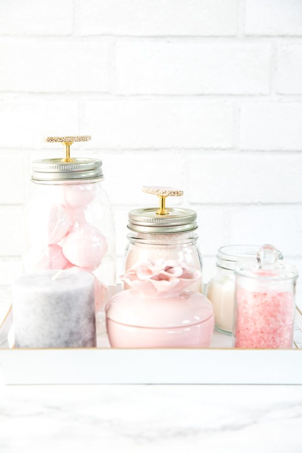 Mason Jar Bathroom Vanity Organizer – how to organize bath essentials like bath bombs, oils, and bath salts on your vanity using mason jars.