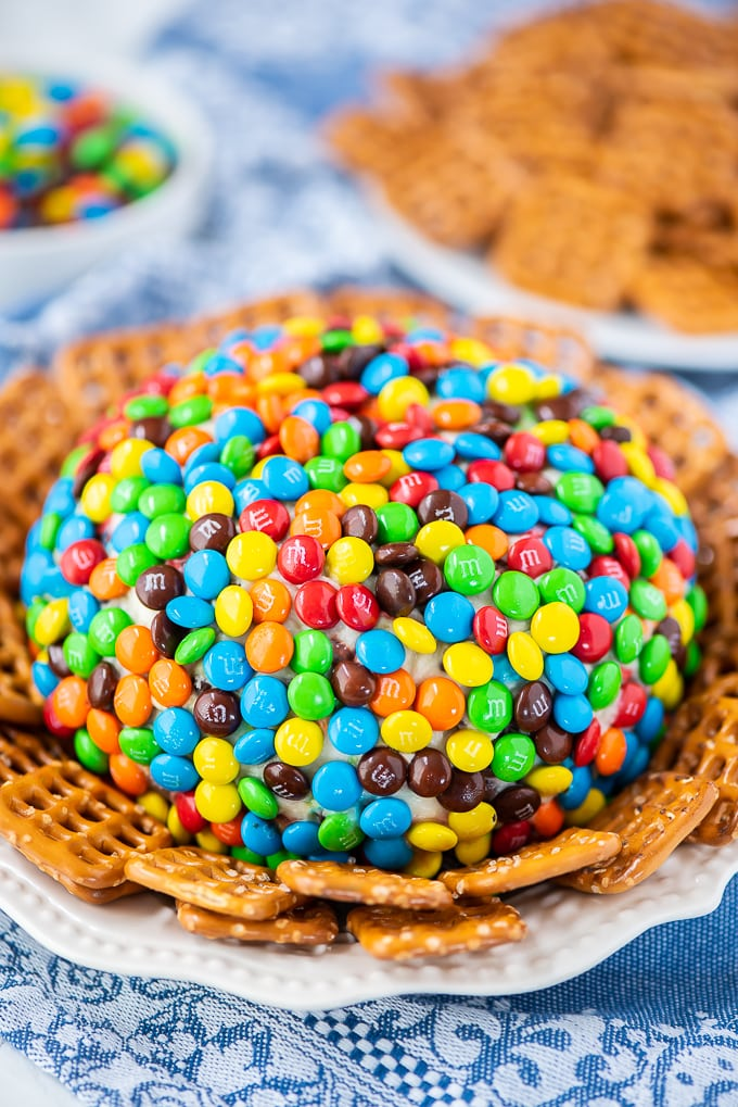 Enjoy this No-Bake M&M Cheese Ball with pretzels for a sweet & salty combo