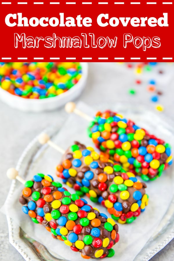 These homemade marshmallows pops are dipped in dark chocolate and covered in M&M's - easy for kids to make and great for parties!