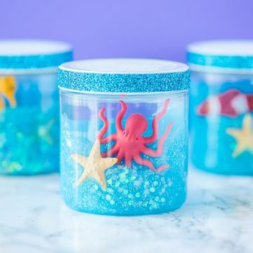 Glitter Ocean Slime jars for an under the sea party or summer boredom buster activity