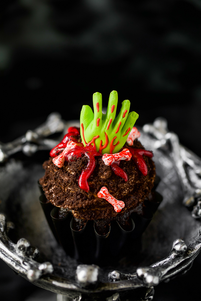 Scary Halloween party food - zombie hand cupcakes