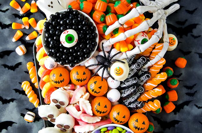 Create a festive Halloween Candy Charcuterie Board on a coffin platter filled with Halloween treats. Perfect for a Halloween party or movie night!