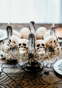 DIY Halloween skull centerpiece with white taper candles