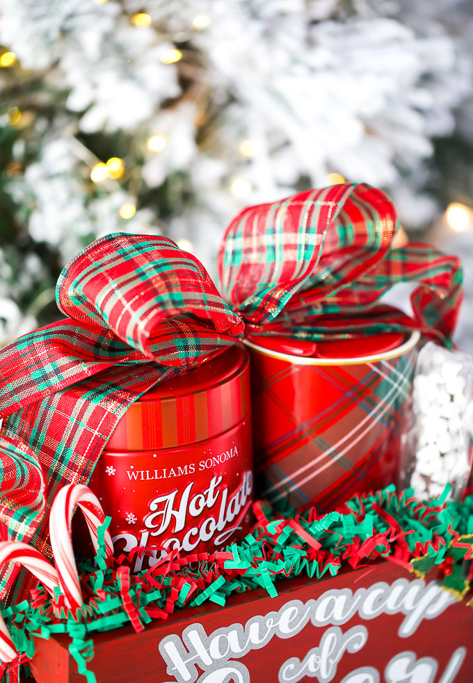 Christmas plaid ribbon bow wrapped around hot cocoa gifts