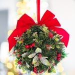 red and green holiday kissing ball decoration