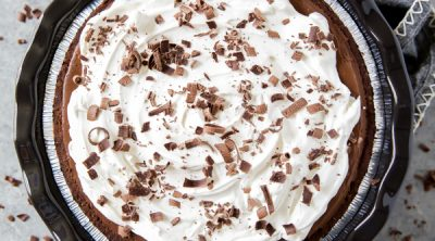 a rich chocolate cream pie with whipped cream