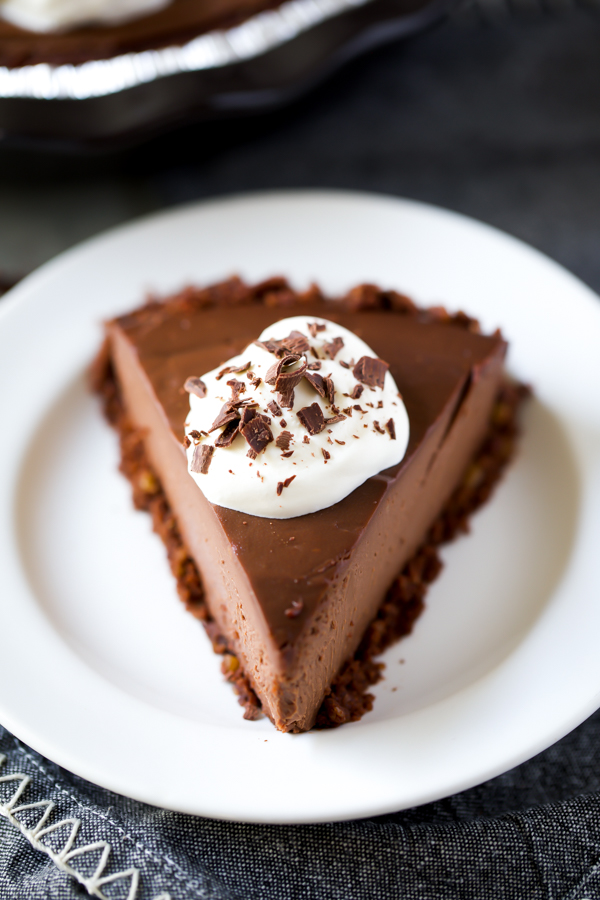 chocolate cream pie slice with whipped cream and chocolate shavings