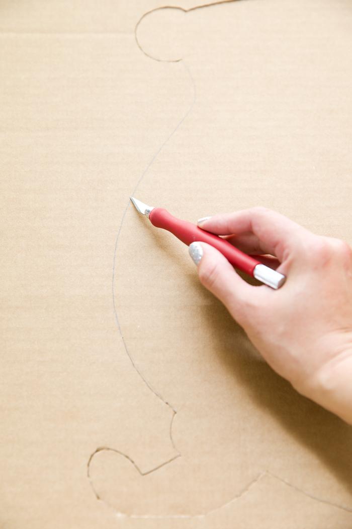 xacto knife cutting cardboard