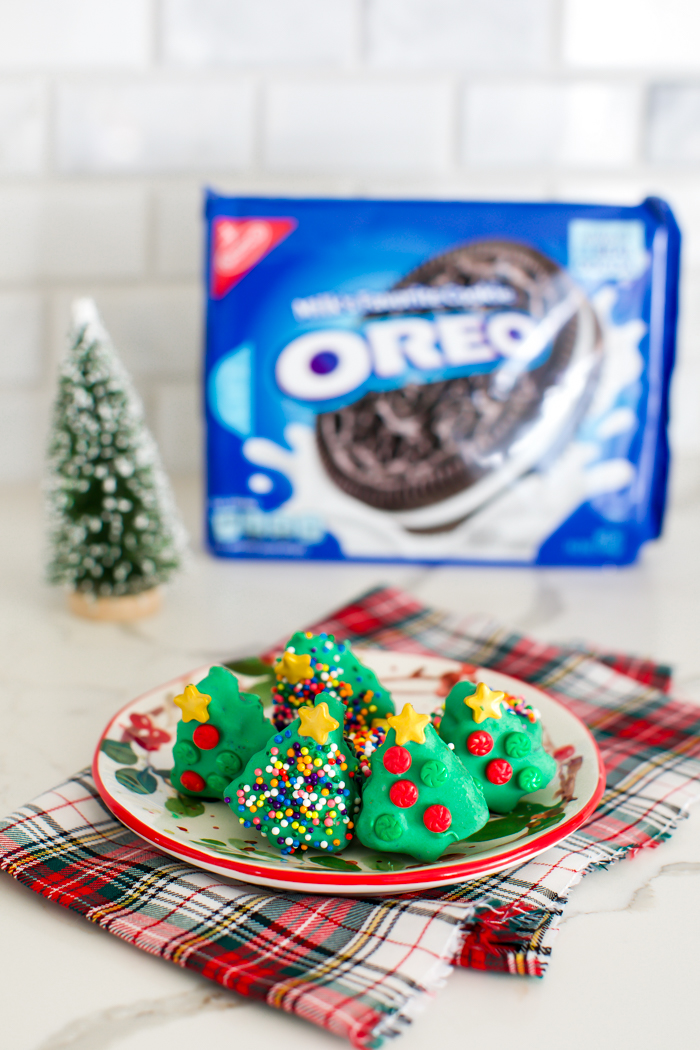OREO balls shaped into trees dipped in green chocolate decorated with sprinkles