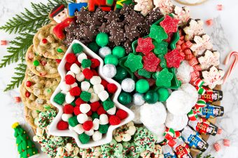 Christmas cookie dessert board with candy and fresh garland decoration