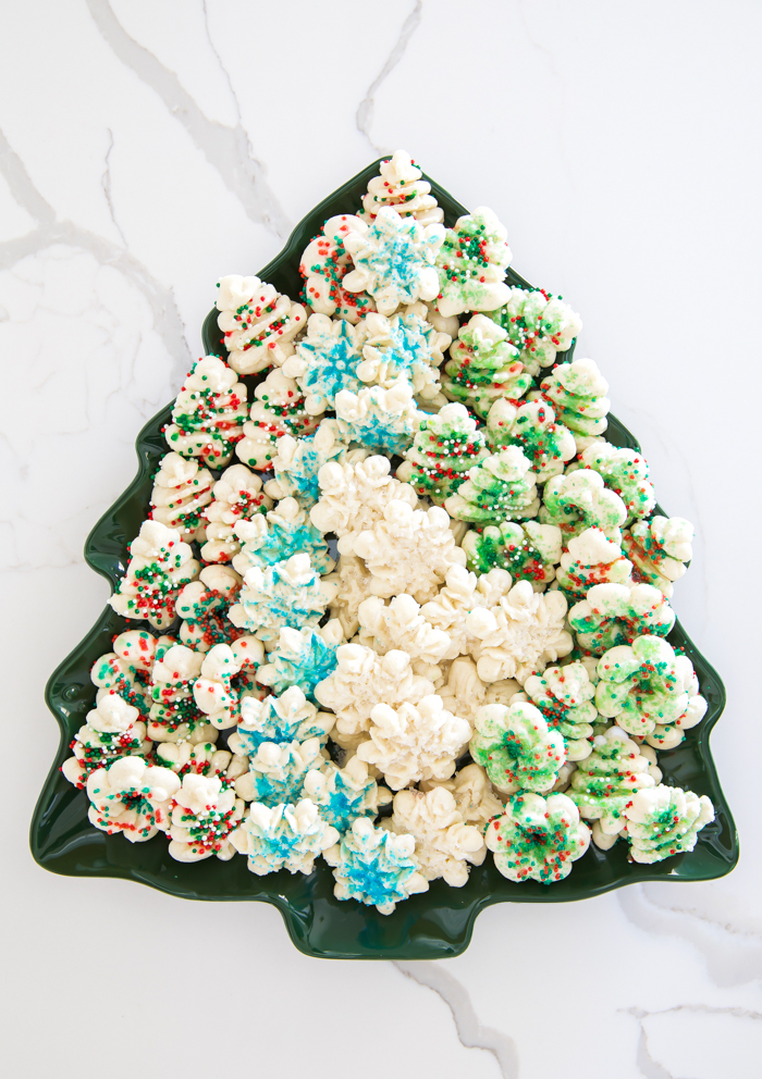 Gluten-Free spritz cookies decorate with sprinkles on Christmas tree platter