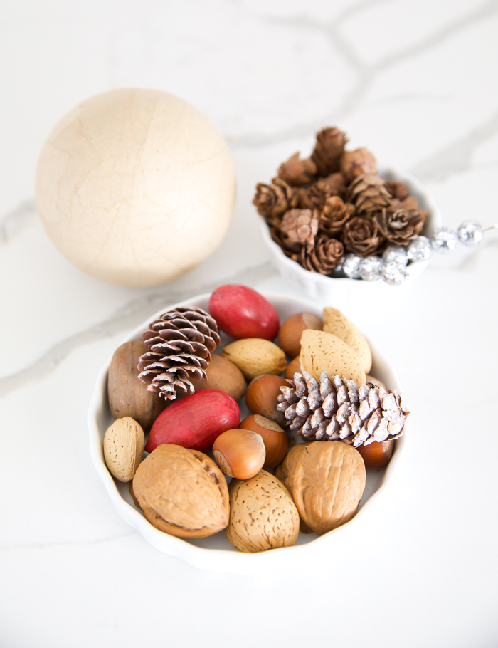 ornament ball made with nuts and pinecones