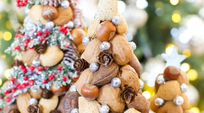 Paper mache Christmas trees made with nuts and pinecones