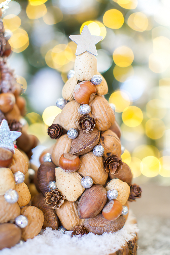 pinecone and nuts holiday decor tree with glitter berries
