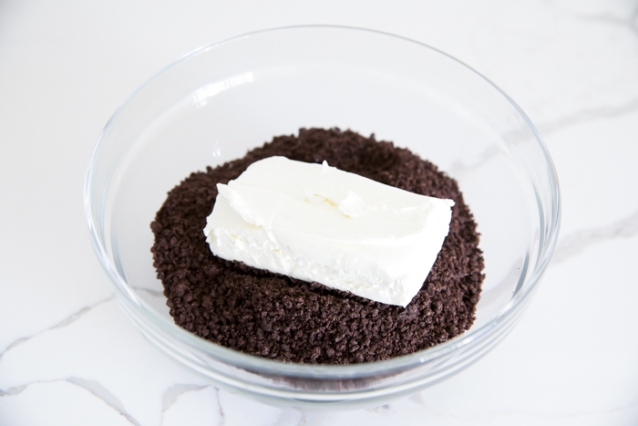 Oreo cookie crumbs mixed with cream cheese