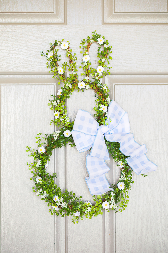 spring wreath with greenery, white daisy flowers, blue gingham ribbon bow inspired by Peter Rabbit