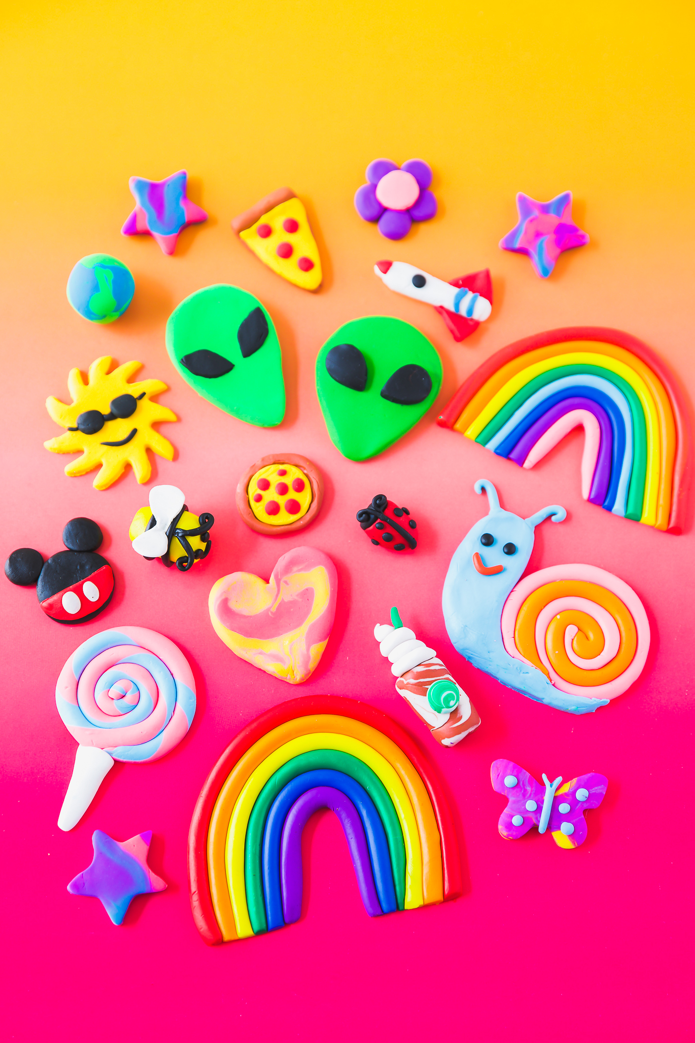 colorful clay eraser designs with a rainbow, Mickey Mouse, and lollipop