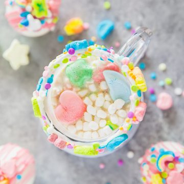 lucky charms marshmallows, white chocolate shell, and rich hot cocoa in a clear mug