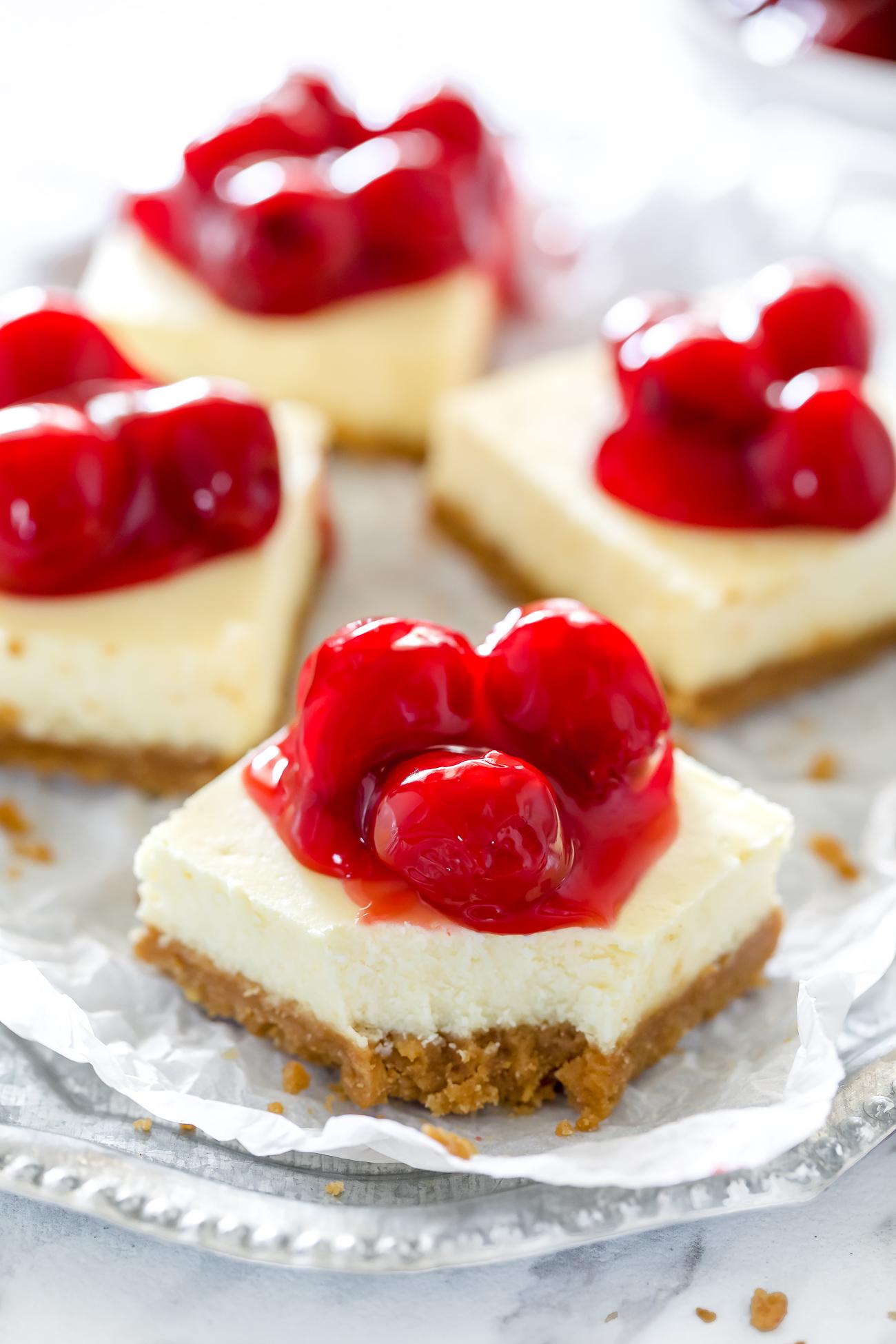 gluten-free graham cracker crust cheesecake bar topped with cherries