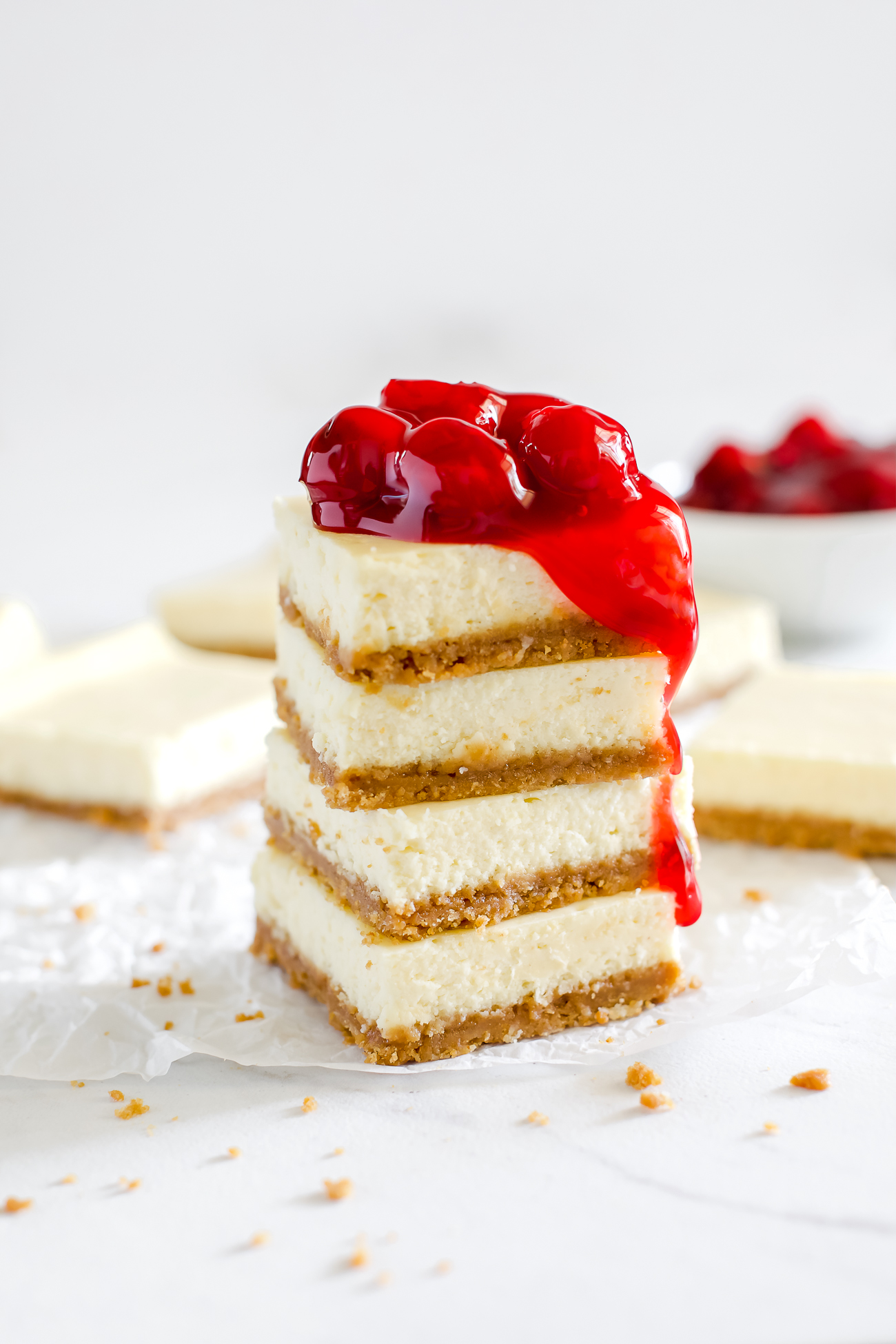 stacked cheesecake bars with cherry pie filling