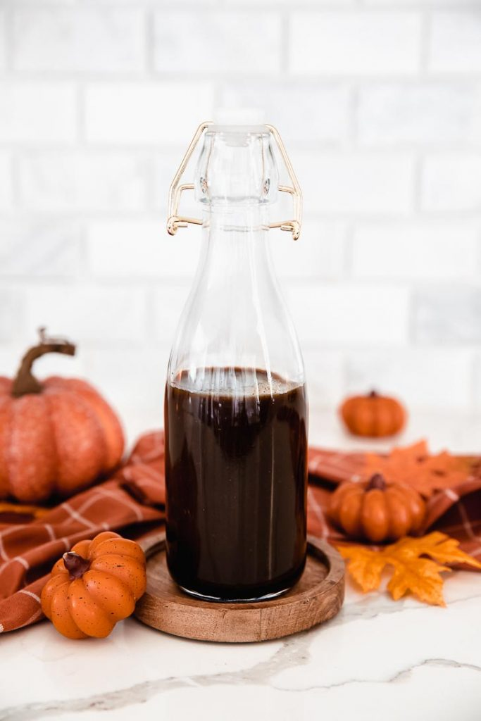 pumpkin spice syrup in a glass bottle