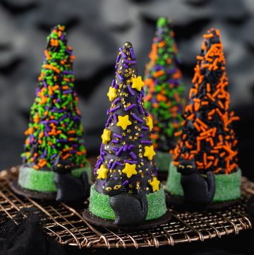 waffle ice cream cone covered in chocolate and decorated with Halloween sprinkles