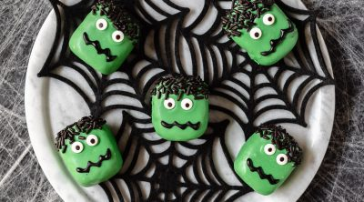 chocolate cookie truffles decorated in green chocolate and candy eyes